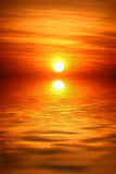 Sunrise over water Royalty Free Stock Image