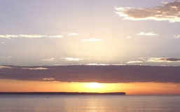 Sunrise over the Water. Sun rising over the ocean at Jervis Bay, Australia Royalty Free Stock Images