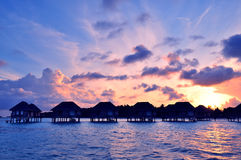 Sunrise over water bungalows in Maldives Stock Image