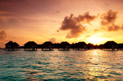 Sunrise over water bungalows in Maldives Stock Images