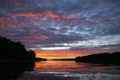 Sunrise over the water Royalty Free Stock Images