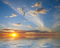 Sunrise over water and sky Royalty Free Stock Photography