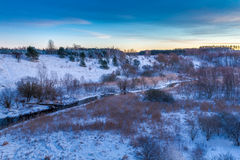 Sunrise over the winter valley Stock Photography