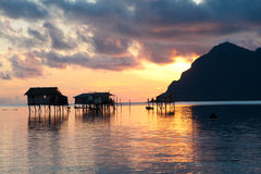 Sunrise over wooden homes on stilts. By the island of Maiga, Sabah, Borneo Royalty Free Stock Images