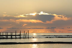Sunrise over a wooden pier Royalty Free Stock Images