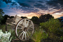 Sunrise over a wooden wagon Royalty Free Stock Image