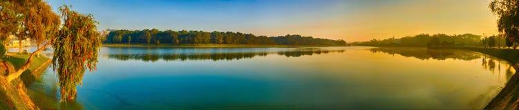 Sunrise over Xuan Huong Lake, Dalat, Vietnam. Panorama. Panoramic view of Da Lat city, little Paris of Vietnam. Amazing view of sunrise over Xuan Huong Lake stock photo