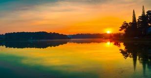 Sunrise over Xuan Huong Lake, Dalat, Vietnam. Panorama. Amazing view of sunrise over Xuan Huong Lake, Dalat, Vietnam. Panorama royalty free stock photos