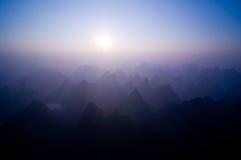 Sunrise over Yangshuo. Sunrise over the limestone mountains of Yangshuo, China Royalty Free Stock Photos
