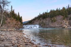 Sunrise overlooking the Bow Falls And River In Banff stock images