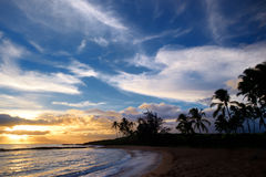 Sunrise with palm trees in Salt Pond Beach Park Stock Photo