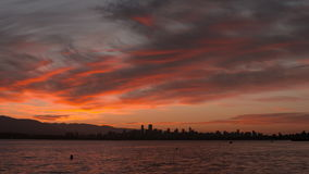 Sunrise pan English Bay, Vancouver 4K UHD. A pan of English Bay and the downtown Vancouver skyline at sunrise. British Columbia, Canada stock video footage