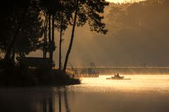 Sunrise in Pang Ung Maehongson Thailand. Morning in Pang Ung Lake,North of Thailand, is a tourist place where people come to vacation in the winter royalty free stock images