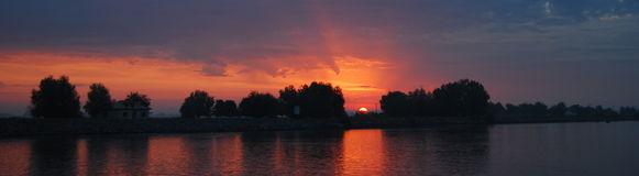 Sunrise panorama. This is an early morning sunrise over the Danube river, in the Danube Delta Stock Photos