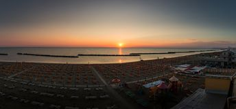 Sunrise panorama on the beach of Torre Pedrera at Rimini in Italy royalty free stock photos