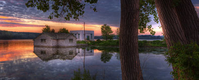 Sunrise panorama of a pump house utility building Stock Photos