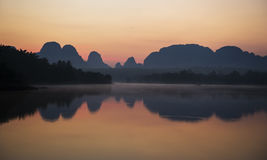 Sunrise panorama sillhouette mountain and river Royalty Free Stock Photography