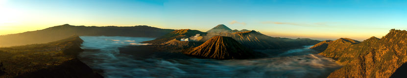 Sunrise panorama at volcano Mount Bromo. Now its bright stock photography