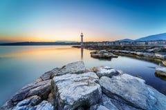 Sunrise at Paquis Lighthouse, Geneva city. Royalty Free Stock Photos