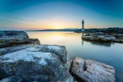 Sunrise at Paquis Lighthouse, Geneva city. Stock Photo