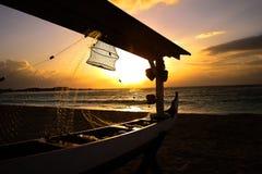 Sunrise Paradise at Ayodya, Nusa Dua, Bali, Indonesia. A wonderful sunrise over the boat at Ayodya Hotel, Nusa Dua, Bali, Indonesia Royalty Free Stock Photo