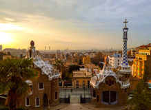 Sunrise in Park Guell. Barcelona, Spain. Sunrise in Park Guell. Awesome architecture of Antonio Gaudi. Barcelona, Spain Stock Photos