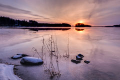 Sunrise at a partly frozen lake HDR photo Royalty Free Stock Photos