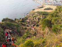 Sunrise Peak, Jeju Island, South Korea. After trekking up to the summit of Sunrise Peak, tourists have to make their way down by another stairway Stock Photography