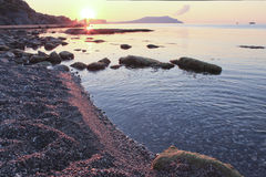 Sunrise on the pebbly coast. In Crimea, September 11, 2013 royalty free stock images