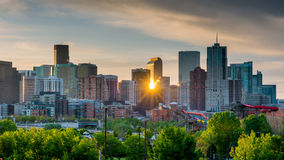 Sunrise peeks through the skyline of Denver Stock Images