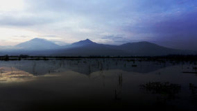 Sunrise at Pening Swamp Rawa Pening, Ambarawa, Central Java. A Peacful Sunrise with Silhouette of Mountain from Central Java, Indonesia Royalty Free Stock Photos