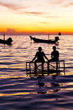 Sunrise people boat  and water in thailand  coastline south chin Stock Photo