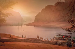 Sunrise in Periyar. Tourists boarding the boat in the Periyar National Park, India Royalty Free Stock Photo