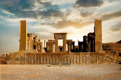 Sunrise in Persepolis, capital of the ancient Achaemenid kingdom. Ancient columns. Sight of Iran. Ancient Persia. Beautiful sunrise background royalty free stock photo