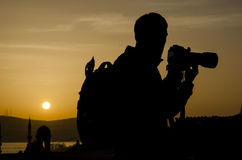 Sunrise photography. Photographers take pictures at sunrise silhouette image the first light in the morning Royalty Free Stock Photo