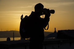 Sunrise photography. Photographers take pictures at sunrise silhouette image the first light in the morning Stock Photos
