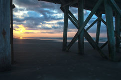 Sunrise Through Pier Royalty Free Stock Photos