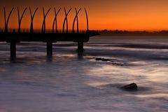 Sunrise Pier. Umhlanga Pier at sunrise with oragne glow Royalty Free Stock Photos