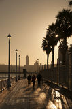 Sunrise on the pier. A cold morning dawns on the dock of the harbor Royalty Free Stock Photo