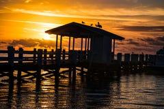 Florida Keys Islamorada Sunrise Silhouette Cheeca Lodge. Sunrise pier dock silhouette at the Cheeca Lodge Resort in Islamorada Florida Keys stock images
