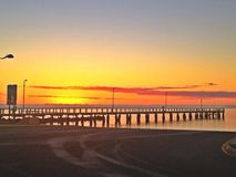 Sunrise at the pier. An empty boat ramp at sunrise, with the pier in front Royalty Free Stock Image