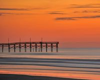 A Sunrise Pier. The sunrise at the sunset beach pier Royalty Free Stock Photography