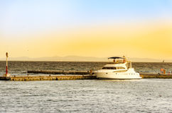 Sunrise pier with yacht Royalty Free Stock Photo
