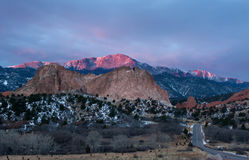 Sunrise on Pikes Peak and Garden of the Gods. Pikes Peak Mountain glows in the sunrise at Garden of the Gods in Colorado Springs, Colorado Stock Photos