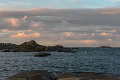 Sunrise with pink sky and clouds over the ocean and archipelago of Faerder National Park, Norway. Sunrise with pink sky and clouds over the ocean and archipelago Stock Photos