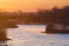 Sunrise on the Platte River. The sun rises over the Platte River, illuminating the fog Royalty Free Stock Photography
