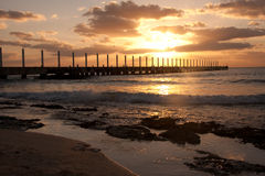 Sunrise at Playa del Carmen, Mexico. A beautiful sunrise over the pier on the Atlantic Ocean in Mexico stock photos