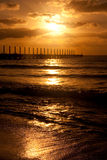 Sunrise at Playa del Carmen, Mexico. A beautiful sunrise over the pier on the Atlantic Ocean in Mexico stock image