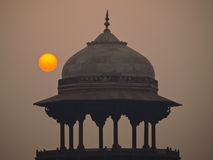 Sunrise through pollution. With Mughal dome, Delhi, India Stock Photography