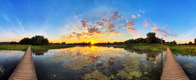 Sunrise pond panorama Stock Photography